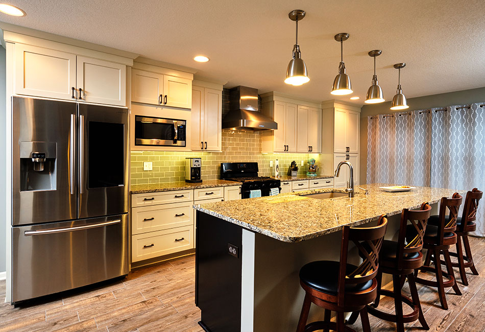 Moehl Millwork provided cabinets and countertops for this kitchen island.